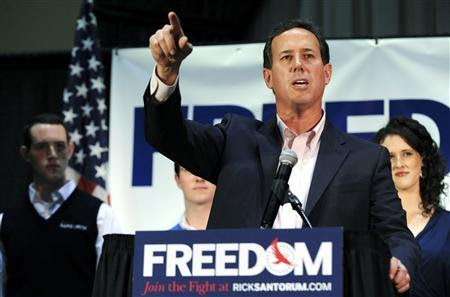 Republican presidential candidate and former U.S. Senator Rick Santorum speaks at his Illinois primary night rally with his son John (L) and daughter Elizabeth (R) in Gettysburg, Pennsylvania, March 20, 2012. REUTERS-Jonathan Ernst