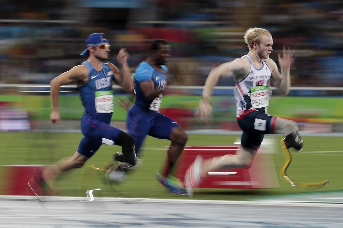 Jonnie Peacock of Team Great Britain (right) won his second-straight gold medal in the men's 100 meters.