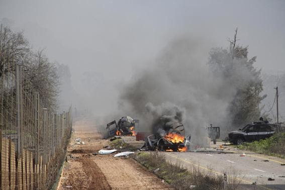 Burning vehicles are seen near the village of Ghajar on Israel's border with Lebanon, January 28, 2015. A Hezbollah missile strike wounded four Israeli soldiers on Wednesday, the biggest attack on Israeli forces by the Lebanese guerrilla group since a 34-day war in 2006. REUTERS-Maruf Khatib