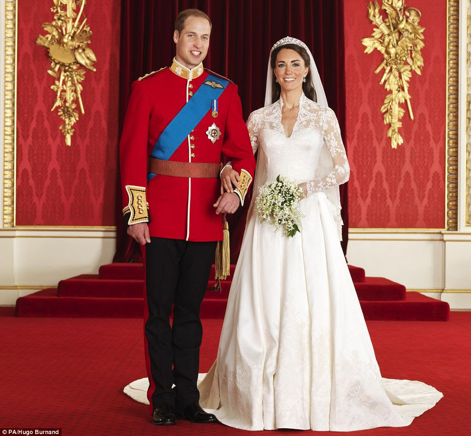 Full over joy: William and Kate smile broadly in the official wedding album
