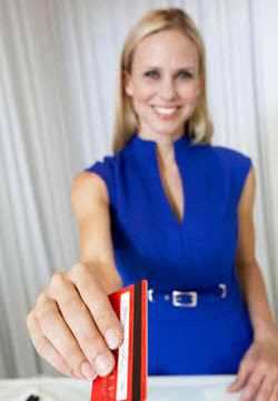 Woman holding out debit card