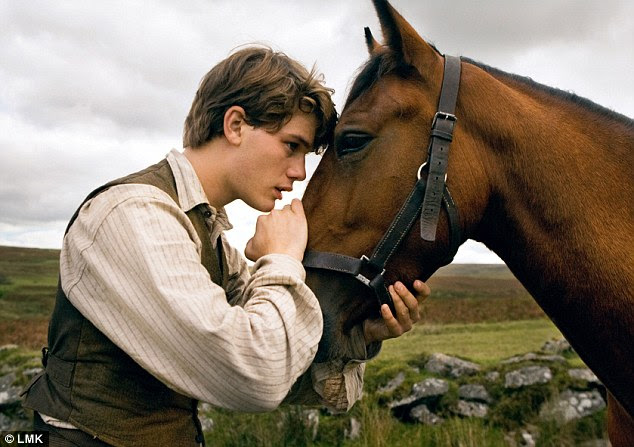 Hero: Jeremy Irvine as Albert and his horse Joey in a scene from the Walt Disney film War Horse