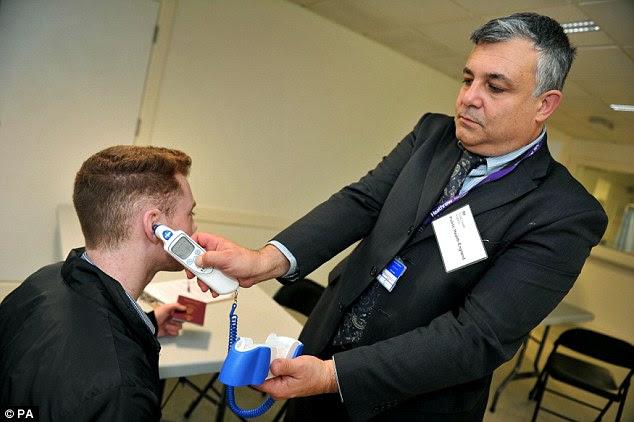 Passengers being screened at Heathrow, as enhanced screening for Ebola begins at Britain's biggest airport