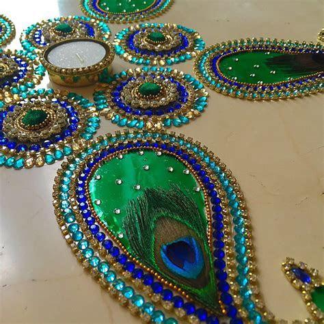Peacock design Kundan rangoli by Suave Collection For