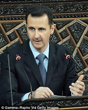 O presidente sírio, Bashar Al-Assad aborda o parlamento em Damasco, Síria, 30 de março, 2011