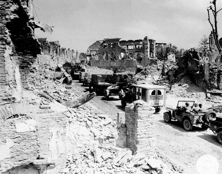 File:Military convoy through Saint Lo.jpg