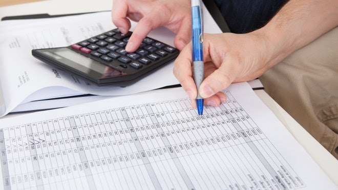 Couple calculating and planning expenses for retirement and budget