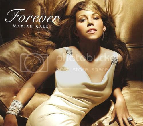 Mariah looking like a wax model in her latest perfume promo