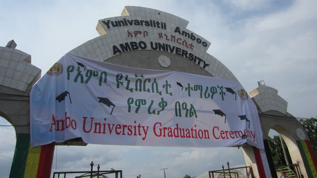 Ambo University's entrance with a sign about a forthcoming graduation ceremony