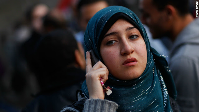 A woman talks on a mobile phone in Cairo's Tahrir Square on February 12, 2011.
