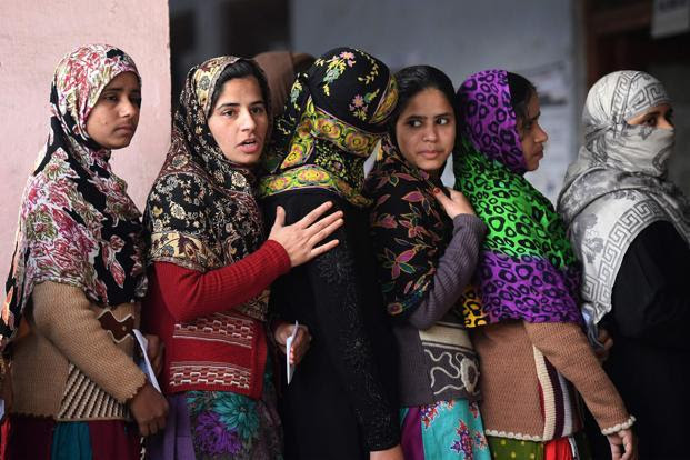 Muslim women queue to cast their votes at a polling station in Muzaffarnagar in Uttar Pradesh on Saturday. Photo: AFP