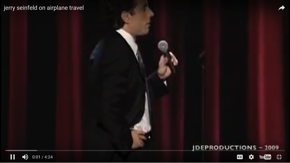Jerry Seinfeld uses the mundane experience of airplane seatbelts and turns it into a funny story.
