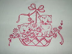 Embroidered cats in a basket 001