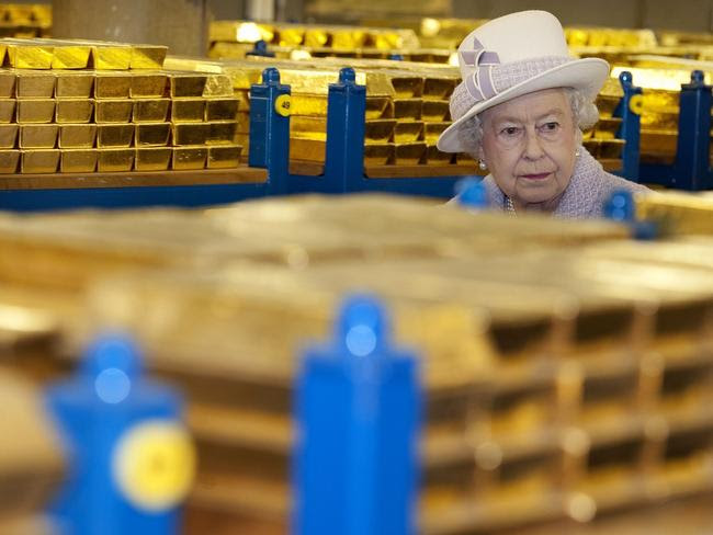 Queen Elizabeth II inspects gold reserves in a vault at the Bank of England.