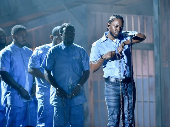Kendrick Lamar performs onstage during The 58th Grammy