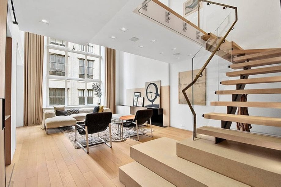 Modern duplex apartment in New York living room and staircase to the second floor