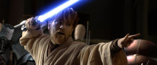 With lightsaber drawn, Obi-Wan Kenobi (Ewan McGregor) prepares to take on General Grievous (off-screen) in STAR WARS: REVENGE OF THE SITH.