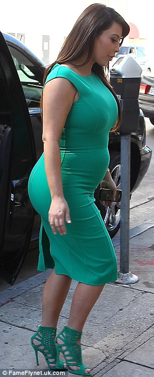 Fitting arrival: Kim showed off her maternity curves in the form-hugging outfit