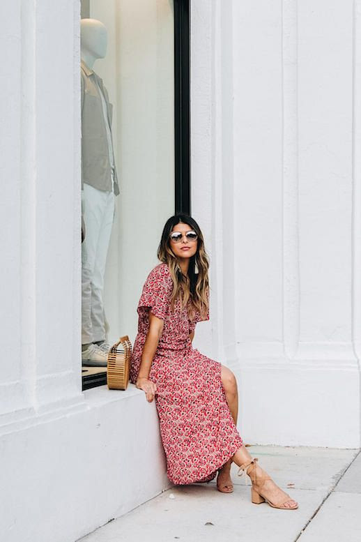 Le Fashion Blog Midi Wrap Dress White Tassle Earrings Wicker Bag Neutral Strappy Heeled Sandals Via The Girl From Panama