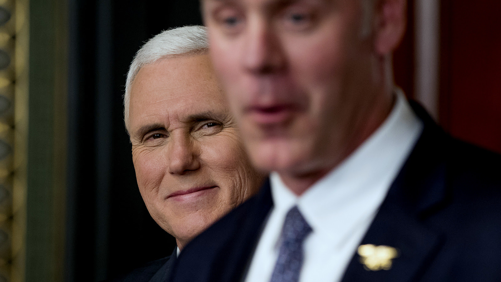 Vice President Mike Pence, left, smiles as newly sworn in Interior Secretary Ryan Zinke speaks, March 1, 2017, in White House. (AP/Andrew Harnik)