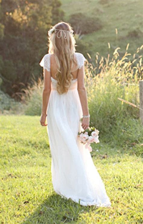 Beautiful low back wedding dress with lace capped sleeves