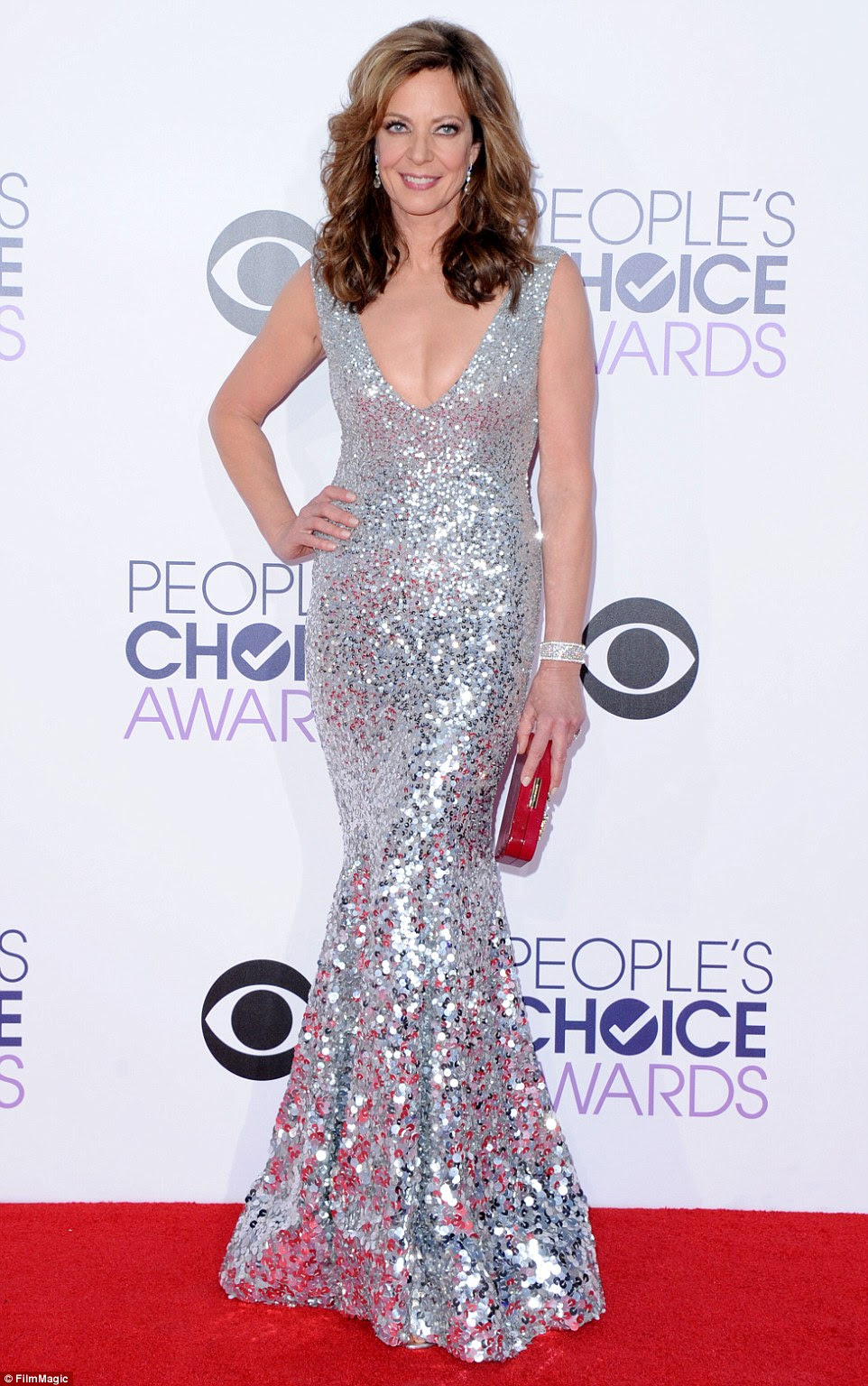 That's one way to stand out in the crowd: Janney took a daring turn in a low-cut silver sequined floor-length gown. The brunette beauty also had 1980s big hair that looked like something Cindy Crawford used to pull off