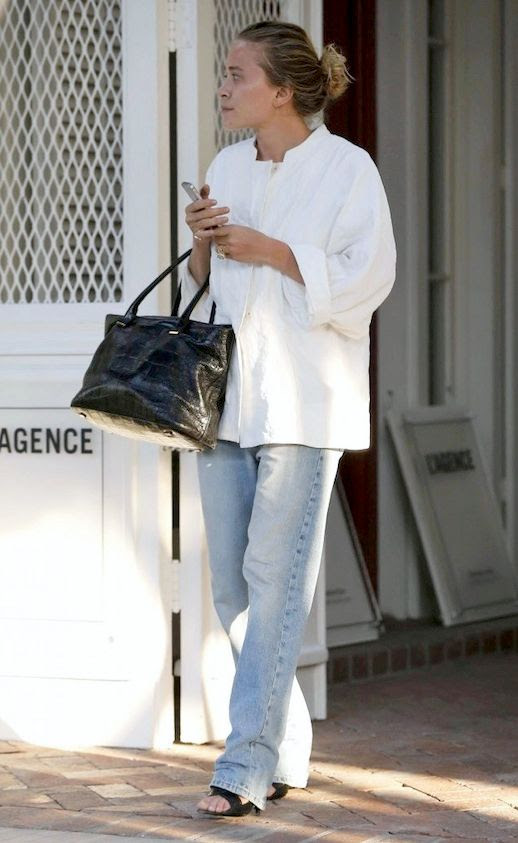 Le Fashion Blog Mary Kate Olsen Low Bun White Tunic Top Relaxed Jeans Croc Embossed Tote Bag L'agence Los Angeles 2014 Side photo Le-Fashion-Blog-Mary-Kate-Olsen-Relaxed-Jeans-Los-Angeles-2014-Side.jpg