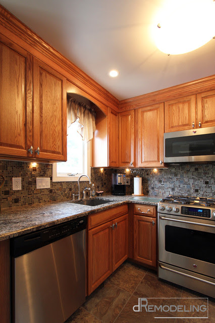 Stainless appliances and hardware with oak cabinets ...