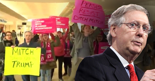 Mitch McConnell Flees Outraged Constituents At Airport Only To Find 400 More At Home - Video