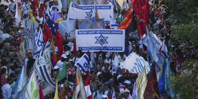 Thousands of Christian Evangelists wave their national flag along with the Israeli one as they march in a parade in the center of Jerusalem, marking the Jewish holiday of Sukkot or the Feast of the Tabernacles. October 14, 2014. (Photo: Nati Shohat/Flas90)