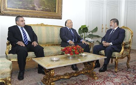 Muslim Brotherhood's President-elect Mohamed Mursi (R) meets with Saad al-Katatni, speaker of the Egyptian parliament and senior member of the Muslim Brotherhood (C) and Ahmed Fahmy, speaker of the Shura Council (the upper, consultative house of Egypt. by Pan-African News Wire File Photos