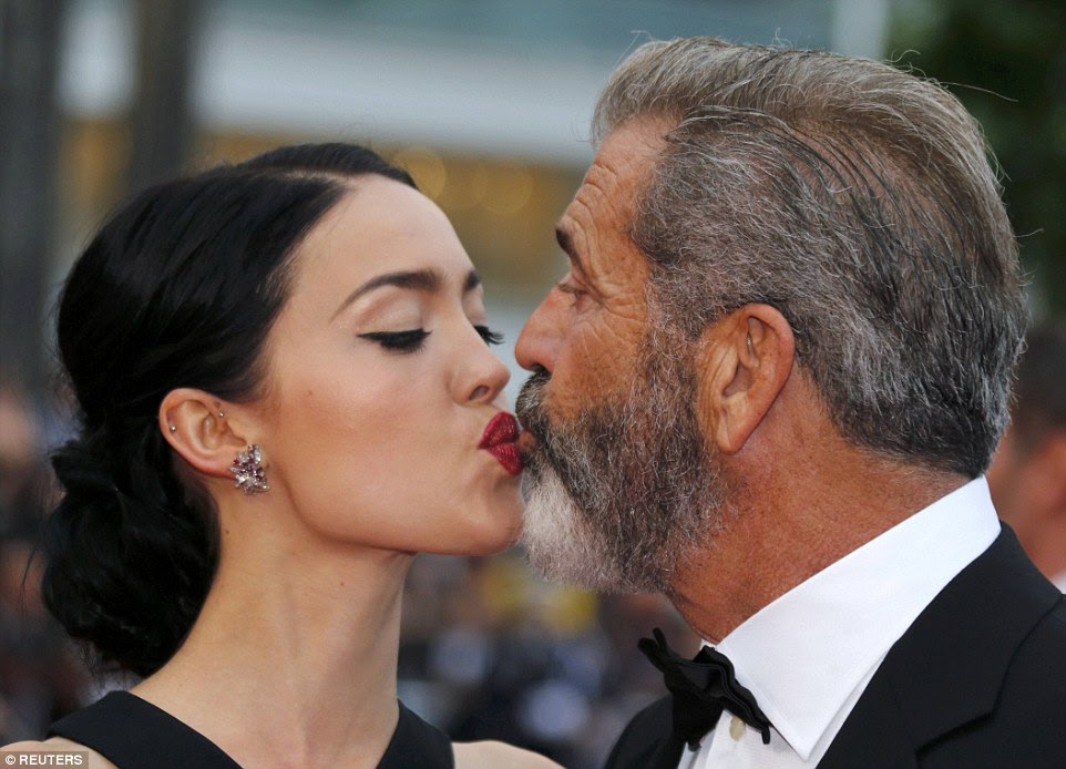 Mwah! Clearly feeling loved-up, the duo couldn't resist indulging in a very public kiss as they posed for photographs on the red carpet