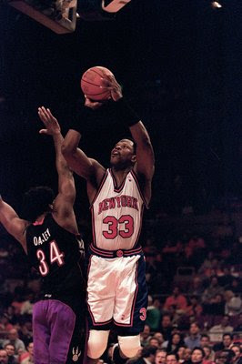 23 Apr 2000: Patrick Ewing #33 of the New York Knicks leaps for the basket as he is guarded by Charles Oakley #34 of the Toronto Raptorsduring the NBA Eastern Conference Round One Game at Madison Square Garden in New York New York. The Knicks defeated the