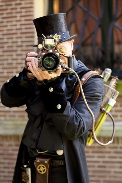 Camera man. I find it interesting that the Dickens festival in Lowell, Mass., has a steampunk aspect to it!