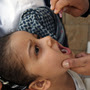 A Yemeni child receives a polio vaccine in the capital city of Sanaa. The Yemen government launched an immunization campaign last month in response to the polio outbreak in neighboring Somalia.