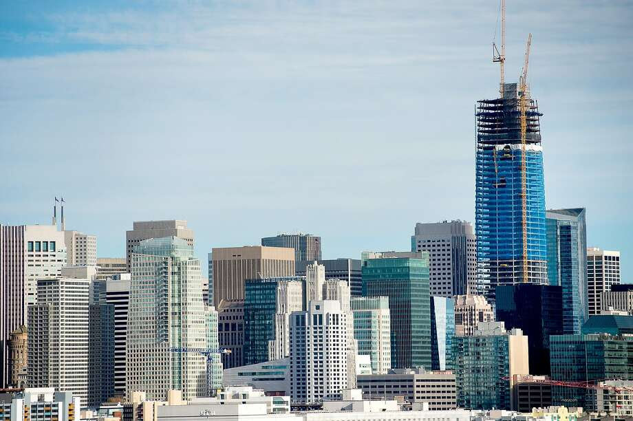 The Salesforce Tower, currently under construction, rises above San Francisco's skyline on Tuesday, Dec. 6, 2016. The perspective is from the rooftop of Rowan, a condo building several miles away on the edge of the Mission District. Photo: Noah Berger, Special To The Chronicle