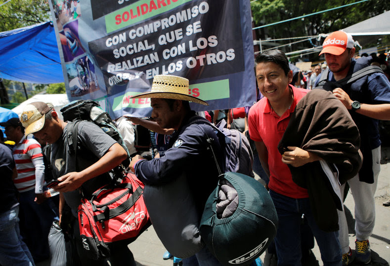 Protesters from the National Coordinator of Education Workers (CNTE) teachers' union arrive in Mexico City to attend the march against President Enrique Peña Nieto