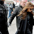 Jazzing up a dreary outfit with some animal magic: Victoria Beckham steps out in a pair of leopard print heels as she catches Eurostar back from Paris