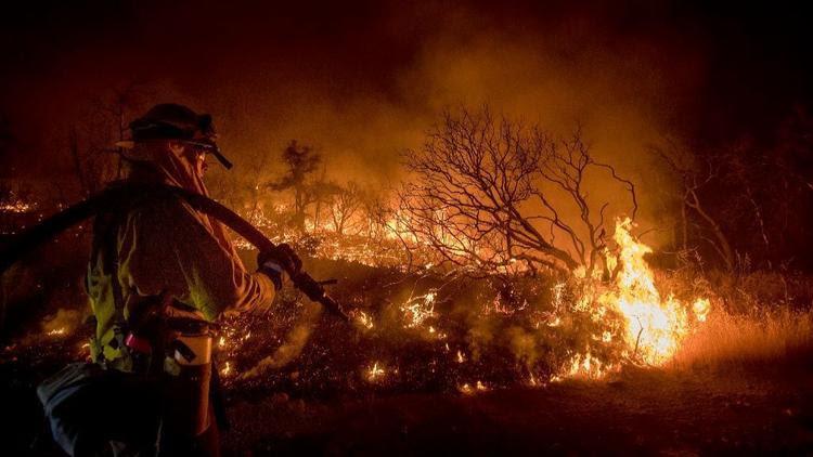 Firefighter Kern Kunst battles the Wall fire near Oroville, Calif.