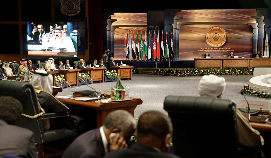 "Arab heads of state meet as King Hamad bin Isa Al Khalifa of Bahrain, seen on screen, speaks, in Sharm el-Sheikh, Egypt. Embattled Yemeni President Abdel Rabbo Mansour Hadi called Shiite rebels who forced him to flee the country ""stooges of Iran,"" directly blaming the Islamic republic for the chaos there and demanding that airstrikes against rebel positions continue until they surrender. Saudi King Salman has vowed that the military intervention in Yemen will not stop until the country is stable. (Associated Press)"