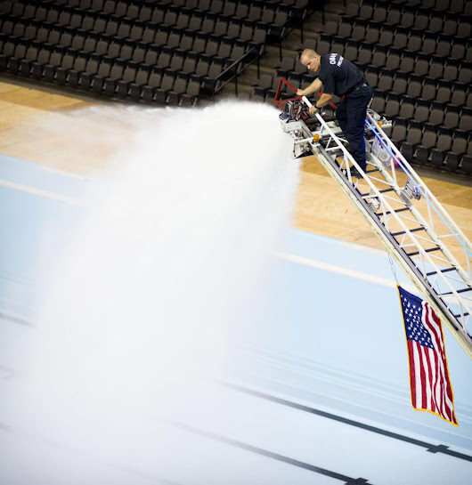 Omaha firefighters lend a hose to fill pools for U.S. Olympic Swim Trials at CenturyLink Center