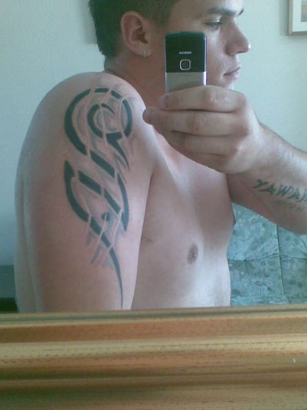Upper Arm Tribal Tattoo