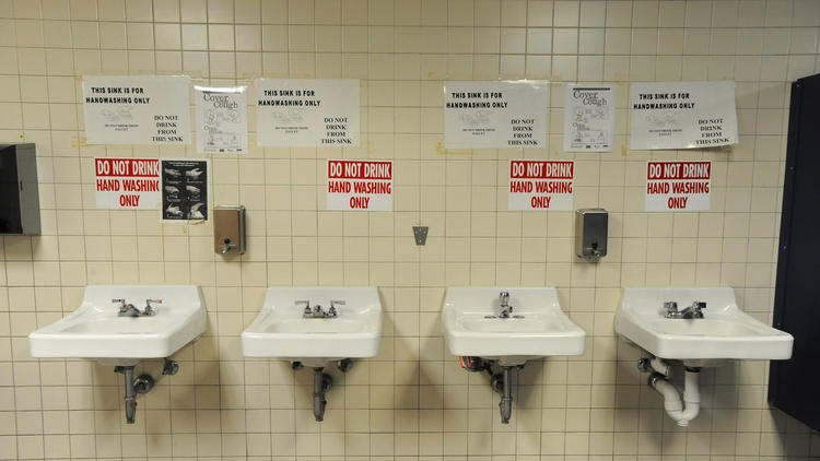 Signs above sinks