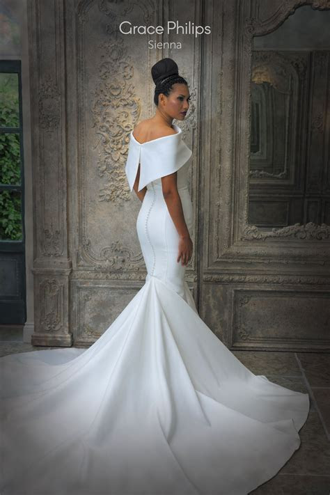A powerful structured fish tail wedding dress with a
