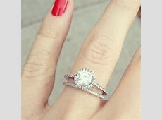 Round diamond with halo ring, narrow shank, and matching skinny band.   Cool wedding rings