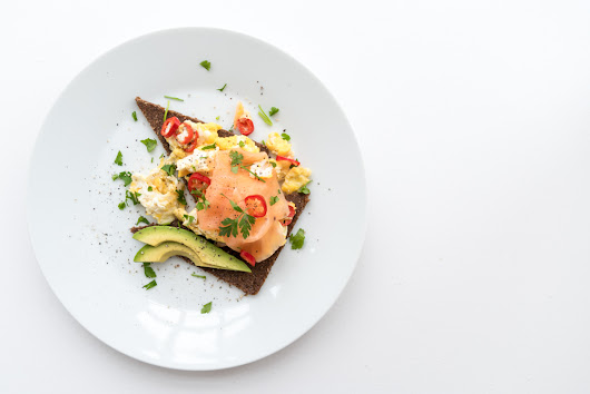 Scrambled eggs with smoked salmon and avocado on rye bread recipe