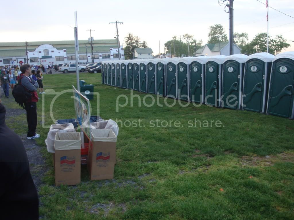 One man line at porta-potties