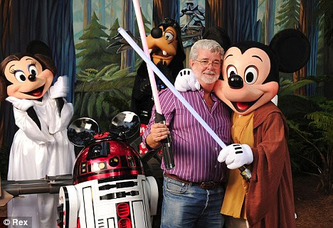 Hugs all round: Star Wars creator Lucas smiles as he gets a hug off Jedi Mickey