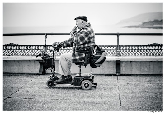 """Man, Mobility Scooter & Harmonica: A Match Made in Heaven"" by wilwardle"