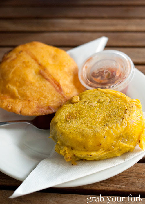 arepa de huevo corn cake with beef egg omelette and papa rellena beef-filled potato at Colombia Organik Sydney